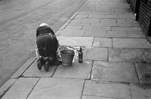 woman mopping street